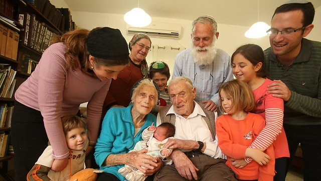 Michael and Marion Mittwochs, center, surrounded by family and holding their 100th great-granchild. (Photo: Elad Gershgoren) (Photo: Elad Gershgoren)