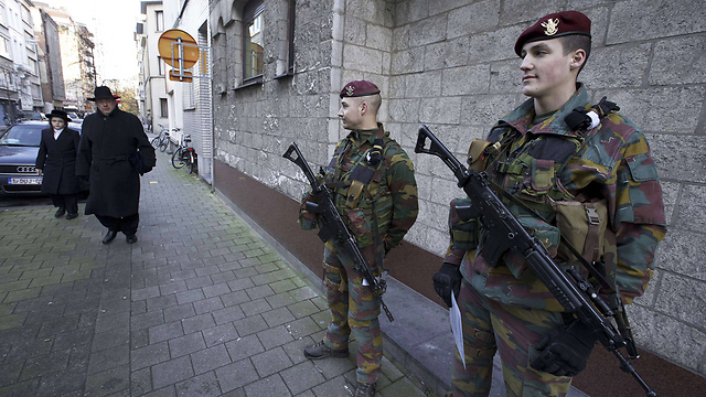 Belgian soldiers patrol Jewish neighborhood in Antwerp, Belgium. While sites are largely guarded, fears for the future of European Jewry inevitably remain (Photo: AFP)