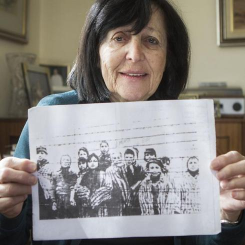 Marta Wise holds a famous photo that has become one of the most iconic images of the Holocaust (Photo: AP) (Photo: AP)