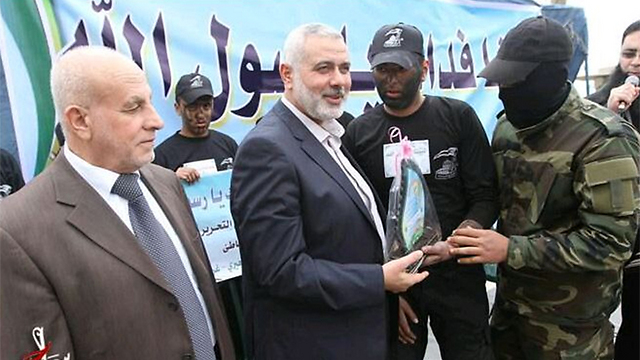 Hamas leader Ismail Haniyeh (center). The resources for Gaza's reconstruction should be given to the effective government in the Strip