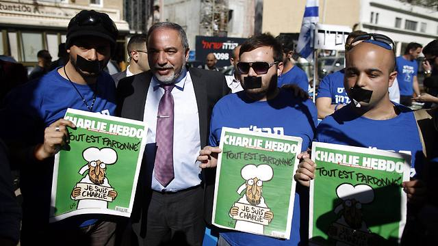 Yisrael Beytenu activists: They will not shut our mouth (Photo: EPA)