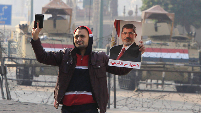 Pro-Morsi demonstrator (Photo: Reuters) (Photo: Reuters)