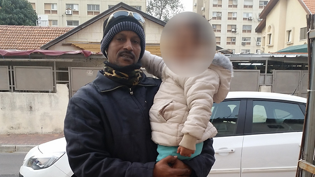 """Habtom Abraha with his daughter. """"They told me 'we'll call you', but they never did."""""""