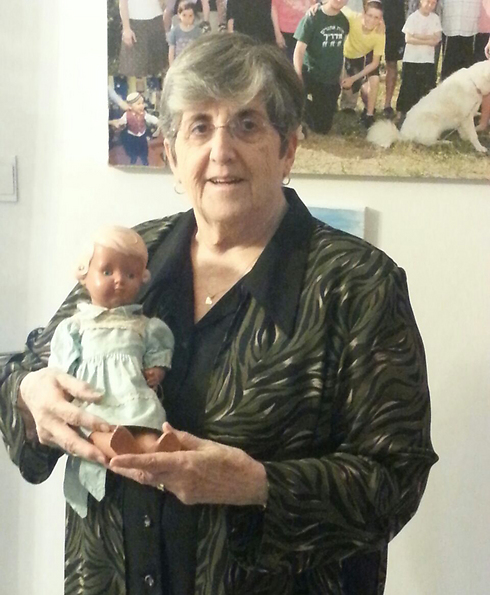 Tzipi Cohen and the doll that saved her life during the Holocaust (Photo: Shem Olam Institution)