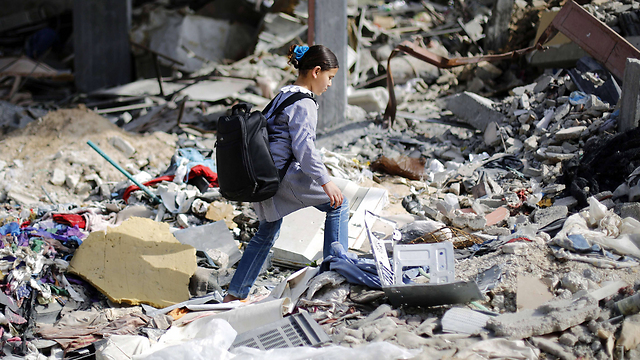 Girl walking through rubble in Gaza in March (Photo: AFP)