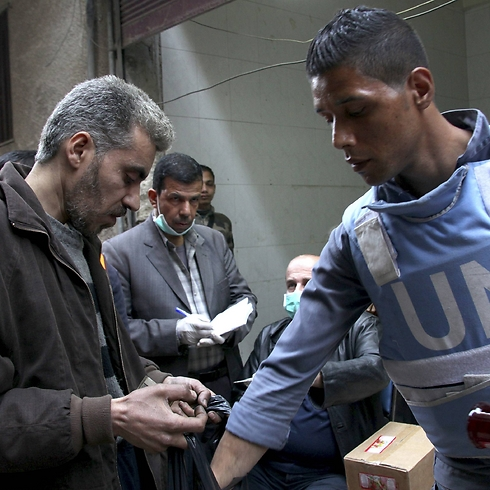 UN aid workers at Yarmouk refugee camp in Syria. (Photo: Reuters)