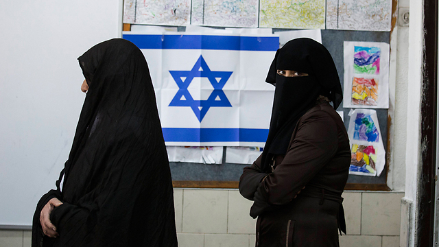 Israeli Arabs are caught in a crossfire between politicians who are competing over 'who will harm the Arabs more' (Photo: AP)