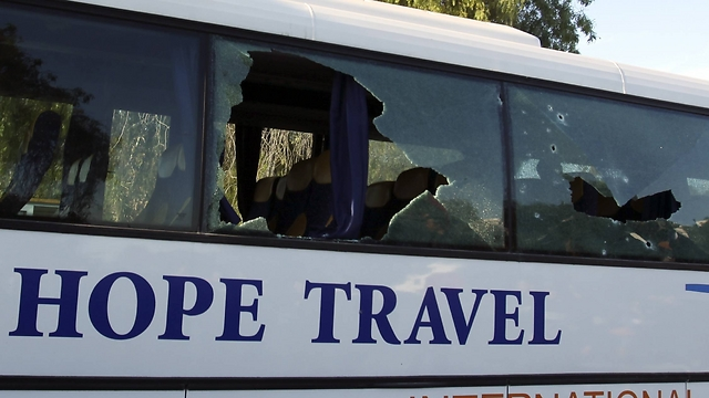 Tourist bus damaged during attack. (Photo: Reuters)