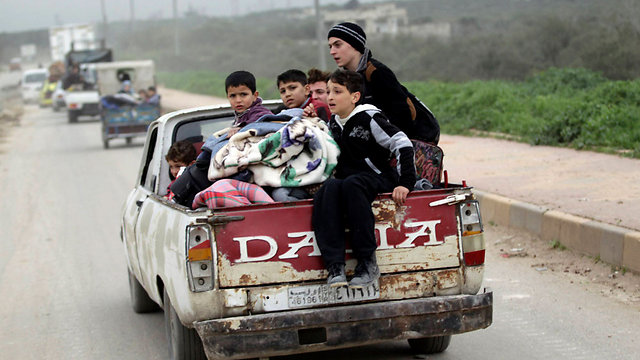 Civilians returning to Idlib (Photo: Reuters)