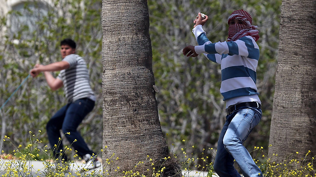 Stone throwers in Silwan (Photo: AFP)