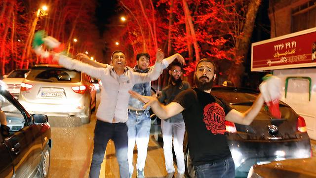 Iranians celebrating nuclear agreement. The common people are transparent to the regime (Photo: EPA)