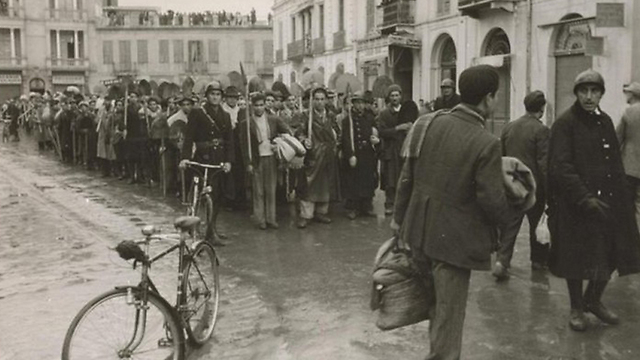 Tunisians being sent to hard labor during WWII
