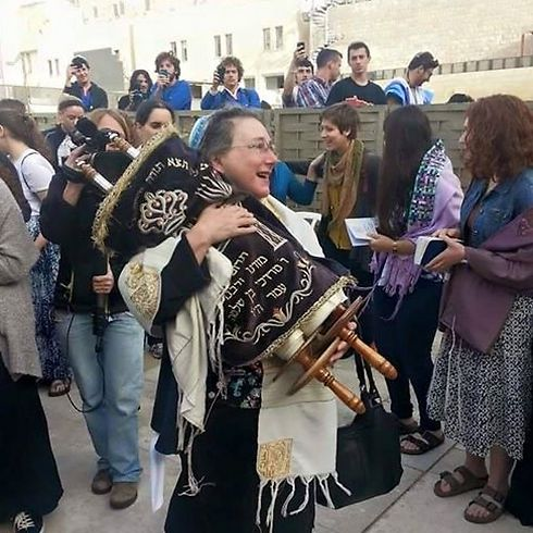 A member of Women of the Wall holds a Torah scroll Monday (Photo: Women of the Wall on Facebook)