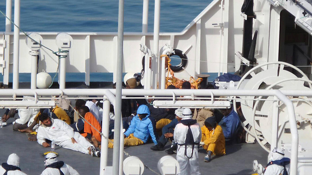 African refugees are held Italy's coastguard earlier this month (Photo: EPA)