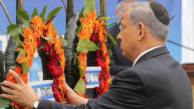 Netanyahu at Memorial Day ceremony. 'Leaders of democracies can become prisoners of their own rhetoric' (Photo: Gil Yohanan)