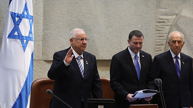 Rivlin being sworn in. 'As president you are facing everything that the people are facing.' (Photo: Gil Yohanan)
