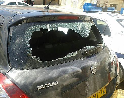 The officer's damaged car