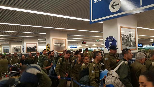 Members of the mission line up in the airport (Photo: Roi Yanovsky)