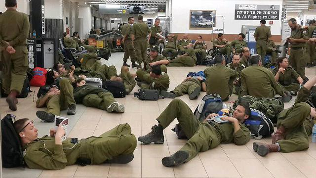 Members of the IDF rescue mission wait in Ben Gurion International Airport (Photo: Yoav Zitun)