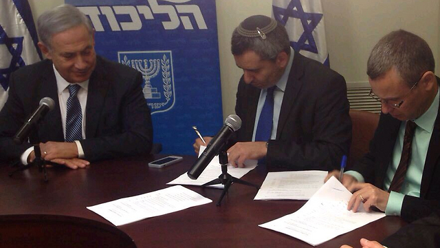 United Torah Judaism members signing the party's agreement with Netanyahu