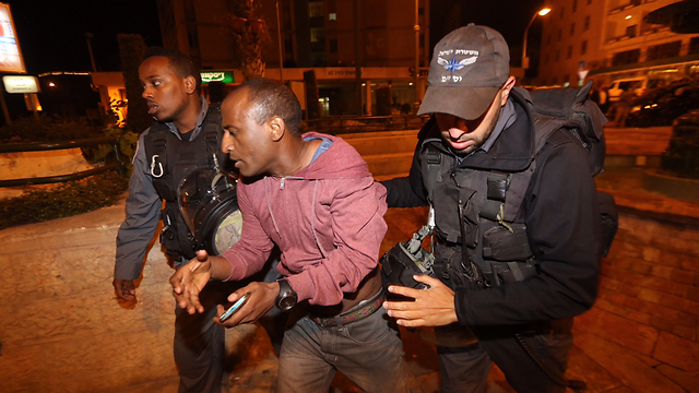 Protester being arrest by police (Photo: Gil Yohanan)
