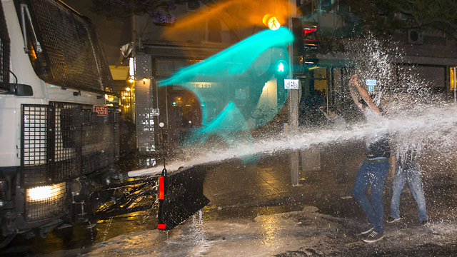 Police use water cannon on protesters in Rabin Square (Photo: AFP)  (Photo: AFP)