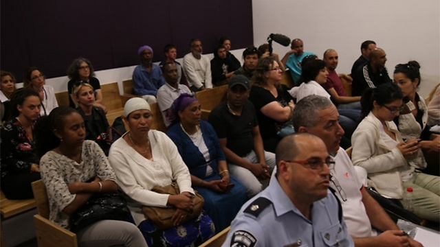 Families of those arrested during protest wait during hearing at Tel Aviv Magistrate court. (Photo: Motti Kimchi)