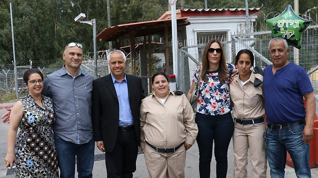 Mor and Tsofit with their families (Photo: Shaul Golan)