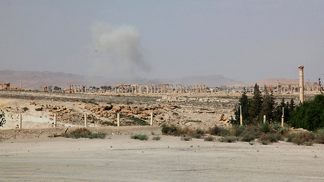 Plumes of smoke rising near the ruins of Palmyra (Photo: Reuters)