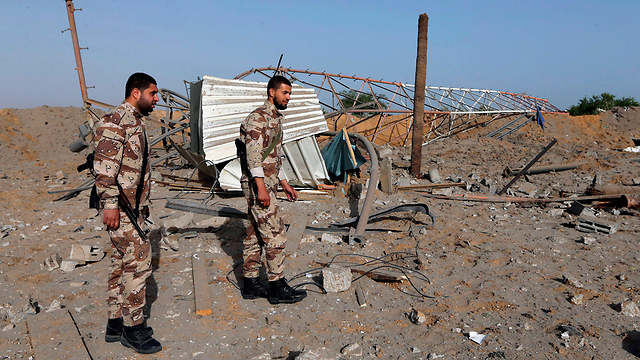 Hamas security forces surveying damage caused by IAF strike (Photo: Reuters)