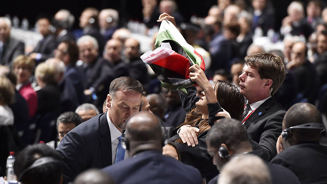 A pro-Palestinian protester interrupts Blatter's speech. (Photo: AFP) (Photo: AFP)