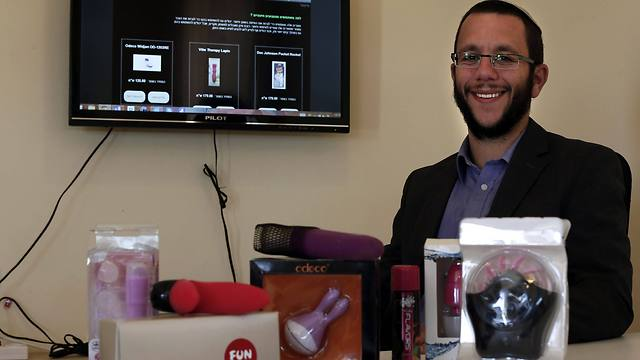 Natan Alexander poses in his office in Elazar in the West Bank with 'Kosher' sex toys (Photo: AFP)