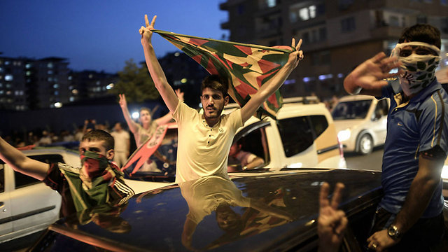 HDP supporters celebrate the early results on Sunday night. (Photo: AFP) (Photo: AFP)