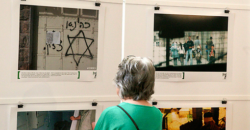 Breaking the Silence photo exhibition. The organization's members, IDF soldiers, have been turned into the punching bag of an impassioned crowd (Photo: Reuters)