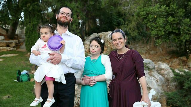 Ayla with her parents and one of her sisters at her Bat Mitzvah (Photo: Moti Yair)