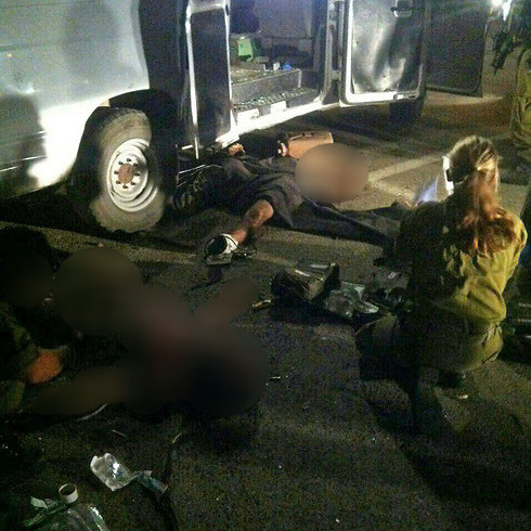 The wounded Syrians taken out of the ambulance after the attack.