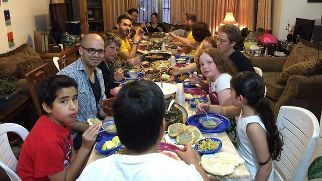Jews and Muslims sit together for an iftar meal in Jerusalem (Photo: Linda Gradstein/The Media Line)