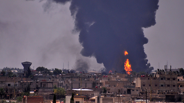 Smoke rises from an Islamic State attack in Hasaka. (Photo: AFP) (Photo: AFP)