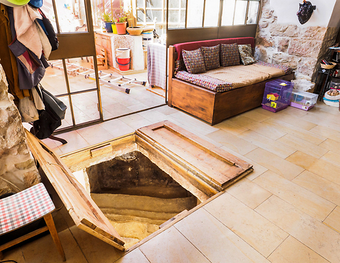 Entrance to the mikveh seen in the couple's living room (Photo: Assaf Peretz/Israel Antiquities Authority)