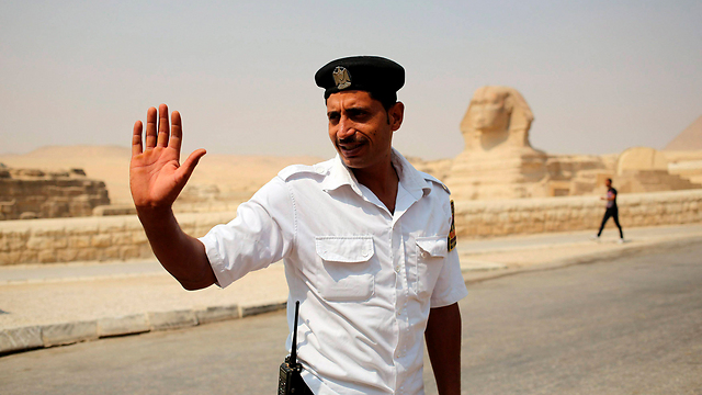 An Egyptian police officer near the pyramids (Photo: Reuters)