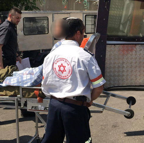 The wounded soldier being evacuated by paramedics (Photo: Tazpit)