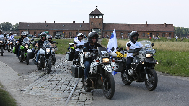 Israeli bikers riding through Auschwitz on their way to the Maccabiah games in Berlin (Photo: Yossi Aloni)