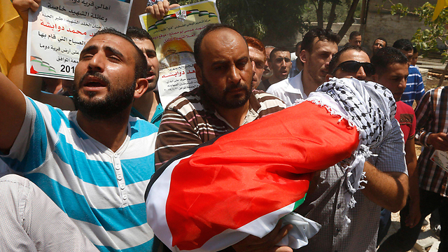 The results of Jewish jihad - an 18-month-old Palestinian is laid to rest after being burned alive by Jewish settlers (Photo: EPA) (Photo: EPA)