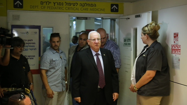 Rivlin visiting the Dawabsheh family at Tel HaShomer (Photo: Motti Kimchi)