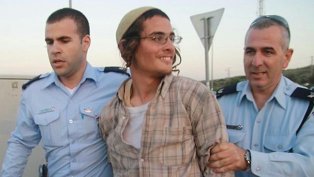 Ettinger in previous arrest (Archive photo: Ehud Amiton, Tazpit)