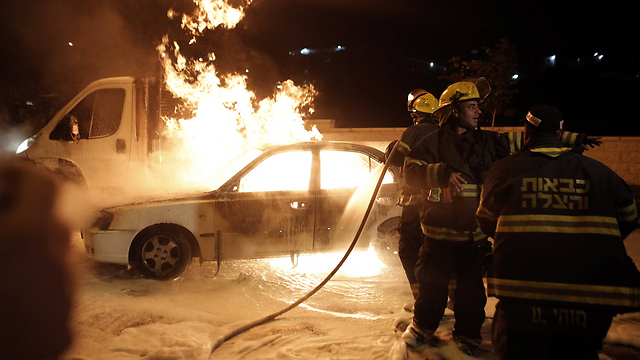 Israeli car burning after being hit by a Molotov cocktail (Photo: AFP)