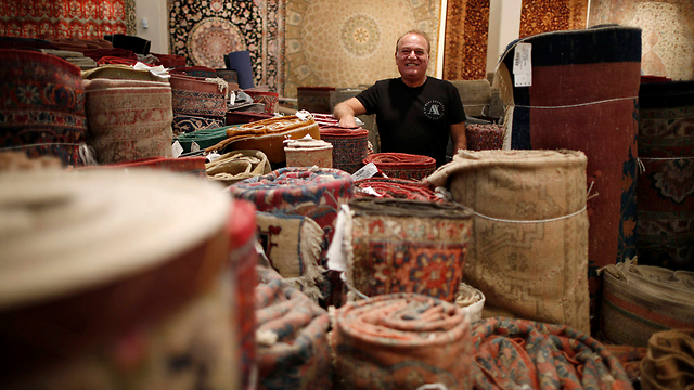 Back to importing Persian rugs (Photo: Reuters)