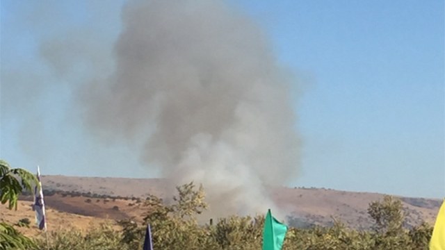 Smoke billows from explosion caused by projectile
