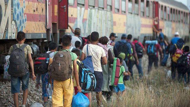 Refugees boarding a train after crossing the Greek border (Photo: AFP)