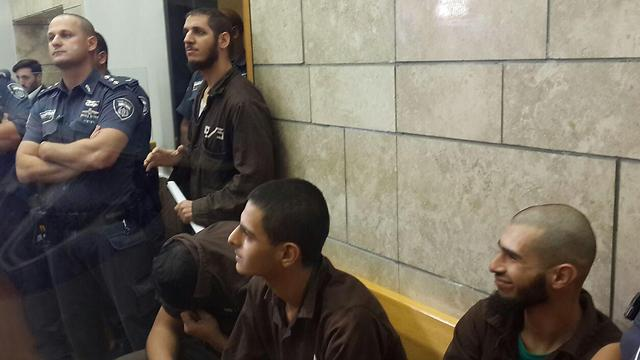 Four of the suspects in court on Thursday. (Photo: Mohammed Shinawi)